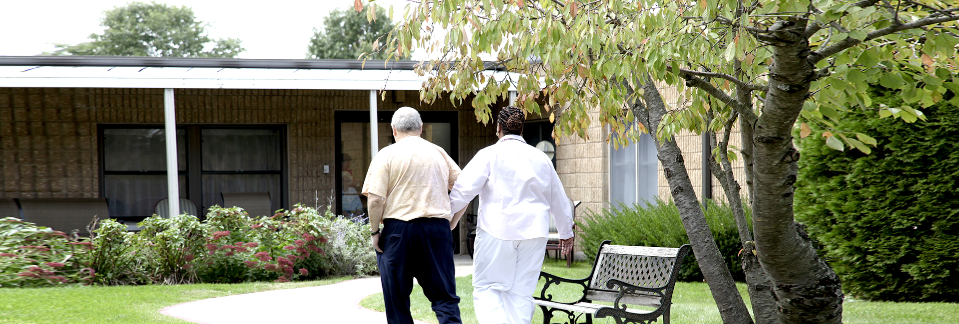 Nurse walking with Patient Photo